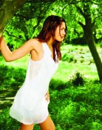 White ruffled V-neck cotton dress by Gracia Fashion. $59. Available at Papillon