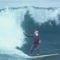 Paul Matthies as Surfing Santa [PHOTOS]