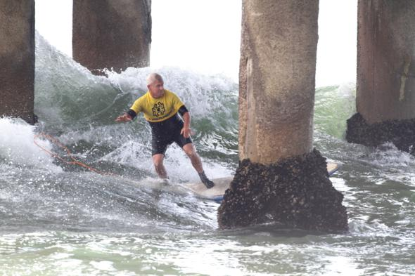 Surfer Mike Purpus shoots Manhattan pier