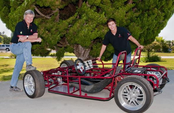 Palos Verdes High School Institute of Technology teacher Graham Robertson pictured with a hybrid-electric urban vehicle designed and built by PV High recent graduate Daniel Doke and his team. Photo by David Fairchild.