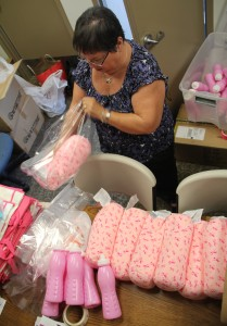 Michelle Memmott, who oversees 27 Soroptomist clubs in the greater Los Angeles area, fills breast cancer comfort bags with pink pillows and water bottles. Memmott started the comfort bags in Manhattan Beach after seeing Santa Barbara's chapter create bags for women who had undergone surgery for breast cancer.
