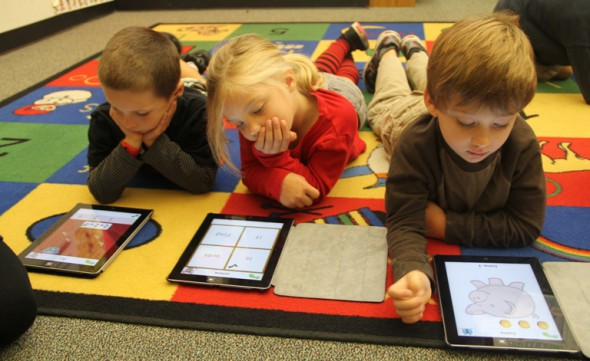Kindergarten students play learning games on the iPad during class. The Manhattan Beach Education Foundation funds the district's 21st Century learning employee, who oversees the iPad pilot.