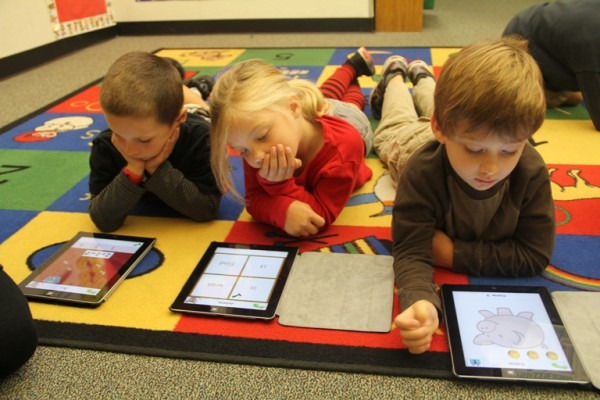 Kindergarten students at Grand View Elementary School use iPads two times a week. Photo by Alene Tchekmedyian