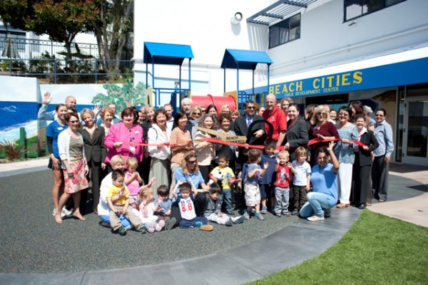 Co-owner Zohra Haji cuts the ribbon for the opening celebrations. Photo by Chelsea Sektnan