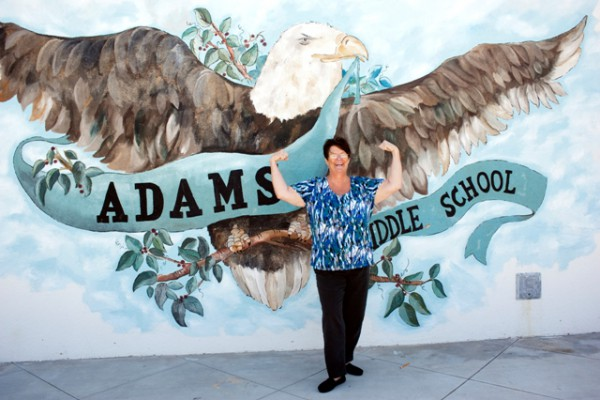 Julie Bassine, who lost 50 pounds, the most weight of the women, poses at Adams Middle School in her now baggy clothes. Photo by Chelsea Sektnan
