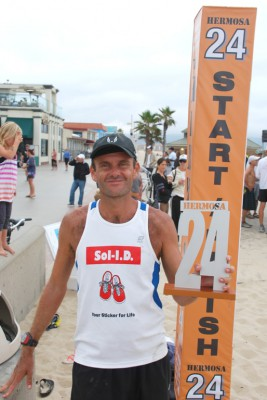 Manhattan Beach native Patrick Sweeney defends his Hermosa 24 title while seeking a new Guinness World Record for the Greatest Distance Run on Sand in 24 Hours. Photo by Randy Angel