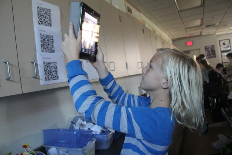 A student uses the iPad at Manhattan Beach Middle school. Next year, they'll each have one to use in and out of the classroom. Photo by Alene Tchekmedyian
