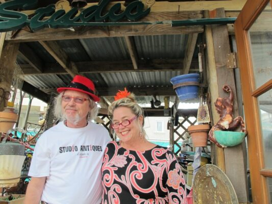 Laurence and Sally Martin, in their bursting antique and collectables shop, Studio Antiques. The couple also travels the world in search of treasures on the Travel Channel's Baggage Battles television show. Photo by Jennifer Passaro