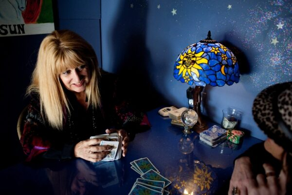 Joy Corradetti reads Jennifer Lippert's tarot cards. Photo by Chelsea Sektnan