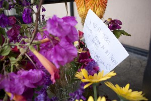 Flowers and letters remember Terie Colecchi. Photo