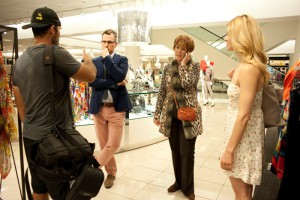 Nordstrom stylist Sean Dennison and Mickey Marraffino talk to a photographer and model about an upcoming shoot before pulling clothes for the event. Photo by Chelsea Sektnan