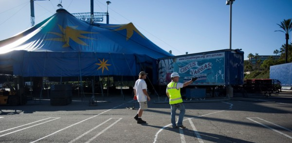 """Circus Vargas travels about 3,000 miles every year. Setting up the tent takes about two days, and everybody, even performers, pitch in to get it ready for show time. """"It's a city without a zip code,"""" said Jon, who is in charge of arranging the things outside of the tent. Circus Vargas was featured in the movie, """"Water for Elephants."""" Jon acted in a couple scenes as a clown."""
