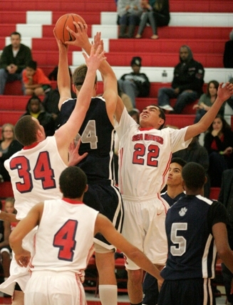 Redondo defenders Austin Leigh, left, and Chris Henderson pressure Rolling Hills Prep 6-foot-11 center Jimbo Lull during action in the Sea Hawk Classic. Photo by Ray Vidal