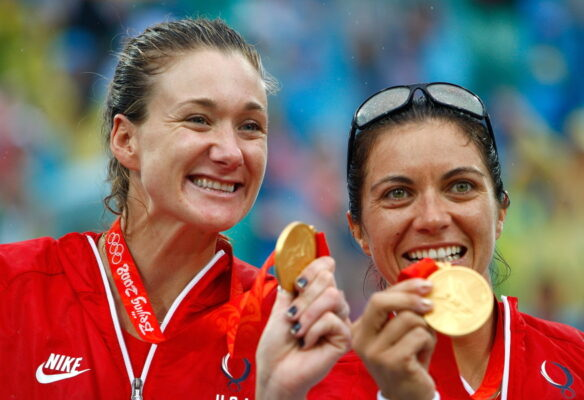 Kerri Walsh and Misty May Treanor show off their gold medals at the Beijing Olympics in 2008. The most prolific team in beach volleyball history ended its career with a gold medal three-peat at the London Olympics. Photo by Jamie Squire/Getty Images