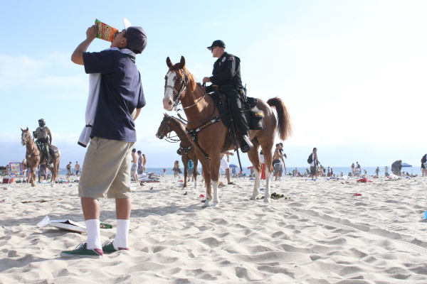 Police on horseback patrol the Second Street beach. Photo by Ed Pilolla