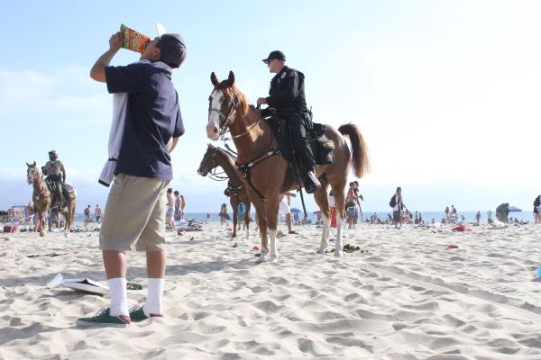 Police on horseback patrol the Second Street beach. Photo by Ed Pilolla