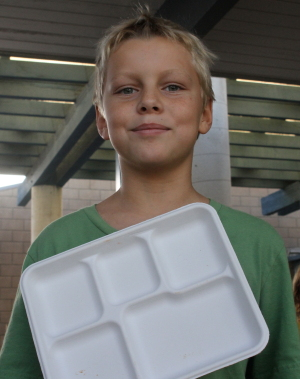 Max Riley, 8, holds a recycled paper tray now used on Fridays at the Hermosa schools. Photo by Ed Pilolla