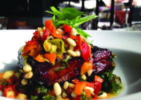 Abigaile's char sui pork belly confit with wilted greens and pepper-pear relish. Photo by Wicked+ Media