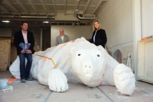 "Bernhard Zuenkeler, Brian Sweeney, and Eva Sweeney with the polar bear sculpture for Michael Sistig's ""Anti-Ark,"" part of a public artwork to be installed on the beach of El Segundo on Feb. 8. Photo by Bondo Wyszpolski"