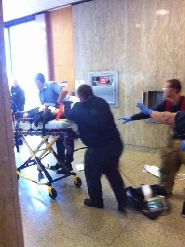 Torrance paramedics rush Larry Delassus out of the Torrance Courthouse Dec. 19. Photo by Bob Khakshooy
