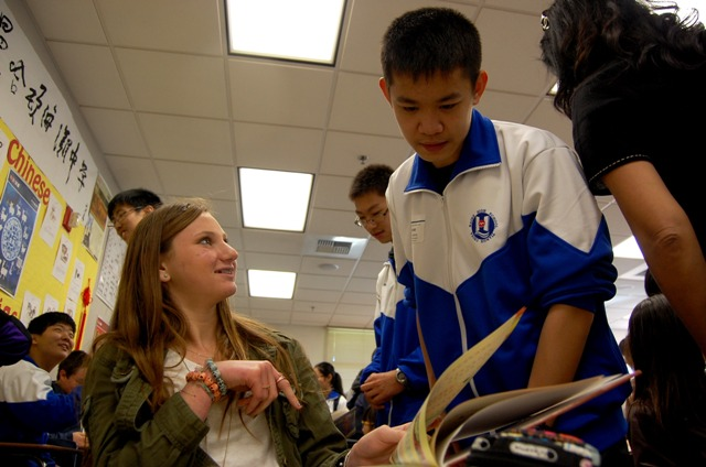 Carly Dossick, an MBMS eighth grader studying Chinese, converses Monday with a visiting student from Tianjin, China. Photo by Esther Kang