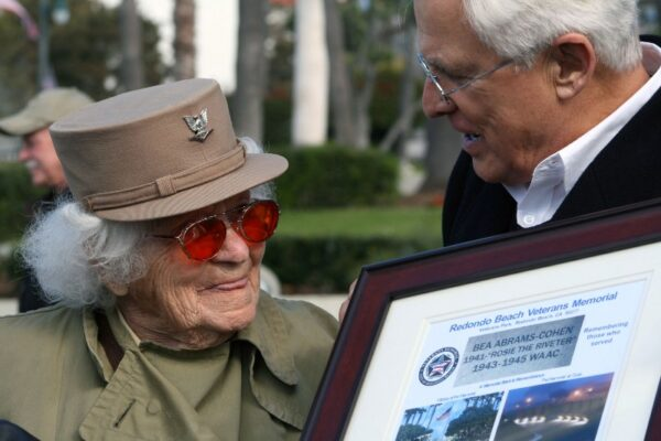 "Bea Cohen, a real-life ""Rosie the Riveter,"" is 102 but still crusading passionately for the welfare of U.S. war veterans. Here she accepts an award from Redondo Veterans Memorial Task Force Chair Herb Masi. Photo by Rachel Reeves"