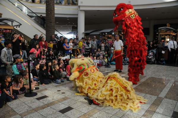 Kids coloring to celebrate Chinese New Year at South Bay Galleria. Photo by Diedre Davidson