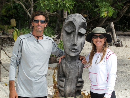 Jake and Jackie Adams pose with a tiki statue in Moorea, French Polynesia.