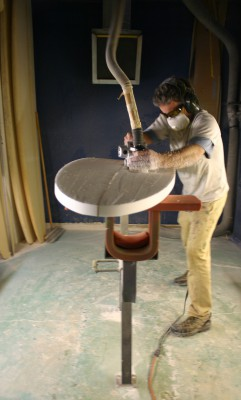 A firm believer of hand shapes, Brog sculpts the bottom of a new shortboard.
