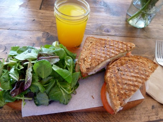 A turkey panini sandwich and salad at The Source.