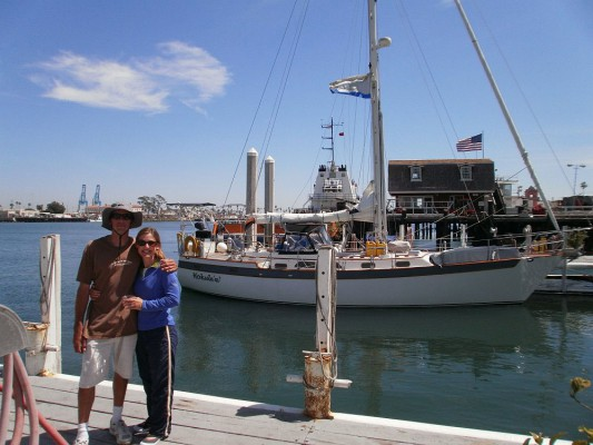Jake and Jackie Adams pose with Hokule'a in King Harbor before setting off on their big round-the-world journey. Photos courtesy of Jake and Jackie Adams