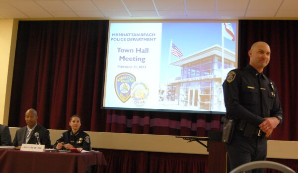 Lt. Christian Eichenlaub (far right) moderates the MBPD Town Hall Meeting at the Joslyn Community Center Monday night. Photo by Esther Kang