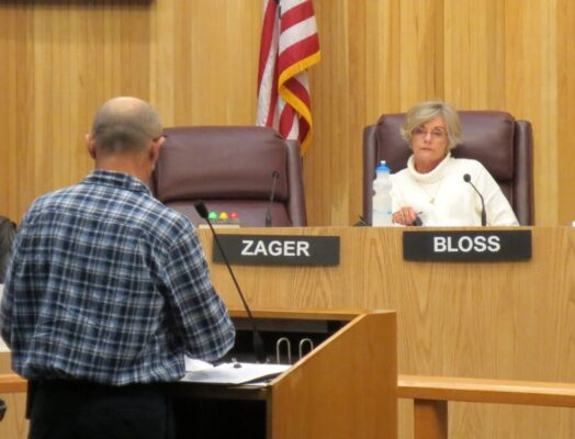 Marina Vice President Sean Guthrie expresses concern over the proposed Harbor Drive redesign to the Harbor and Planning Commissions Thursday night. Photo by Rachel Reeves