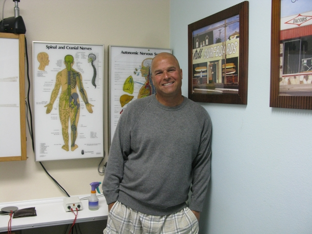 Dr. Derek Levy in his Hermosa Beach office. Photo by Kevin Cody