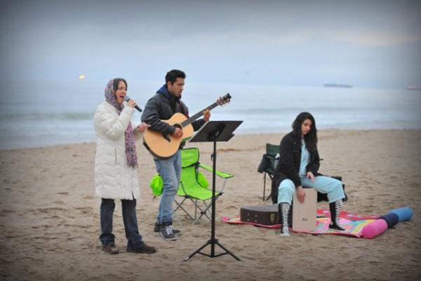 Music director and vocalist Bobbi Lynn Lambert with guitarist Cesar Ballardo and Gina Fletcher on cajon drum box.