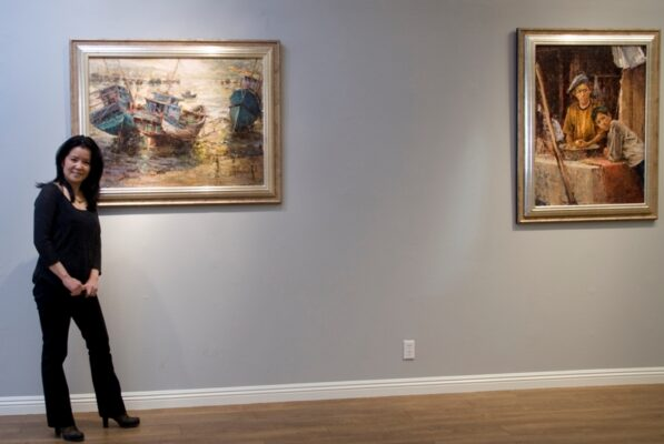 Artist and museum director Dali Higa with her work. Photo by Gloria Plascencia