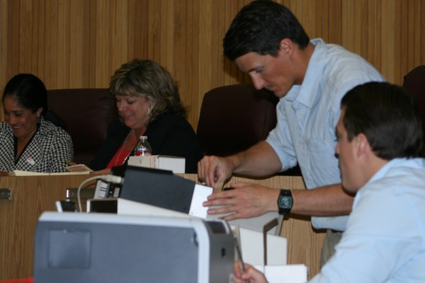 Votes being counted on Tuesday night at City Council Chambers. Photo by Rachel Reeves