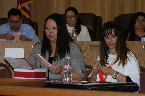 Absentee ballots being counted at City Council Chambers Tuesday night. Photo by Rachel Reeves