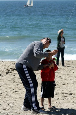 A boy gets flying lessons at the 39th Annual Festival of the Kite in Redondo Beach. Photo