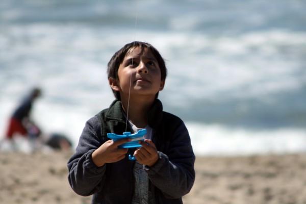 A boy keeps an eye on his kite at the Redondo Kite Festival on Sunday. Photo