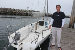 Wes Houston with one of the 26-foot J80s he teaches students to sail.