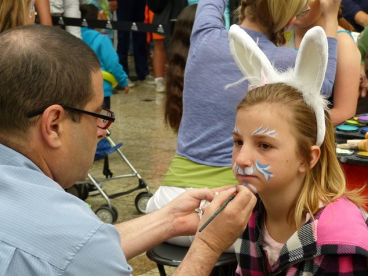 A girl gets her face painted to look like the Easter Bunny at the South Bay Galleria last weekend. Photo by John Healy