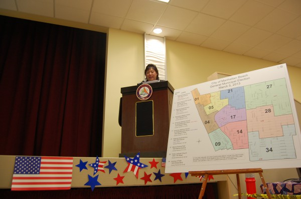 Manhattan Beach City Clerk Liza Tamura announces the results of vote-by-mail and precinct ballots as they roll in Tuesday evening at the Joslyn Center.