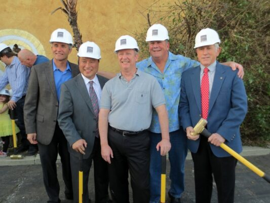 Councilmember Bill Brand, Mayor Mike Gin, and councilmembers Matt Kilroy, Steve Aspel, and Pat Aust pose with ceremonial sledgehammers to mark the initiation of the Shade Hotel Redondo Beach project. Photo by Rachel Reeves