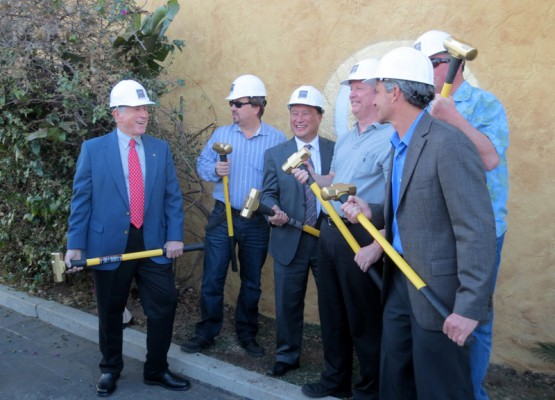 Councilmember Pat Aust, Shade Hotel owner Michael Zislis, Mayor Mike Gin, and councilmembers Matt Kilroy, Steve Aspel, and Bill Brand, pose with ceremonial sledgehammers to mark the initiation of the Shade Hotel Redondo Beach project. Photo by Rachel Reeves