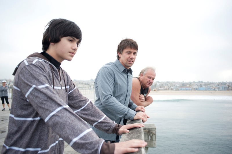Stuntmen Jason Lockhart and Chris Robbins taking tips from veteran stuntman Don Gilley as they prepare to jump from the Hermosa Pier. Photo by Chelsea Sektnan