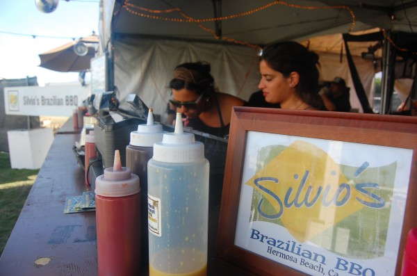 Mila and Julia, Silvio's BBQ part-timers and recent transplants from Brazil, await the next wave of customers Saturday afternoon.