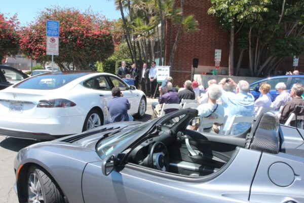South Bay Assemblyman al Muratsuchi announces a bill to reduce state fees on alternative fuel vehicles in from the Hermosa Beach  city hall charging stations. In the foreground are an electric Tesla roadster and a Tesla Model S sedan.  Photo by Kevin Cody