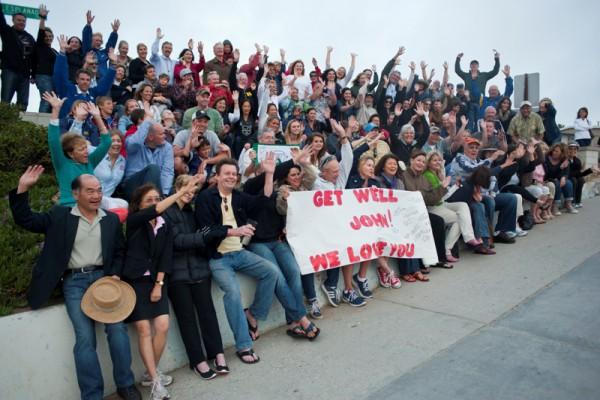 Over 100 friends gathered at the end of Avenue I in Redondo Beach to send a photo of support to Boston Marathon victim John Odom. Photo