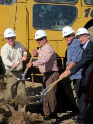 "Council members Matt Kilroy, Steve Diels, and Pat Aust join a development partner in ""breaking ground"" for two new hotels that will fill the void left behind by the Malibu Castle mini-golf course. Photo by Rachel Reeves"